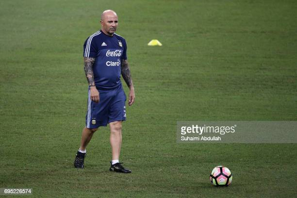 Argentina coach Jorge Sampaoli kicks the ball during an Argentina training session at National Stadium on June 12 2017 in Singapore Argentina is...