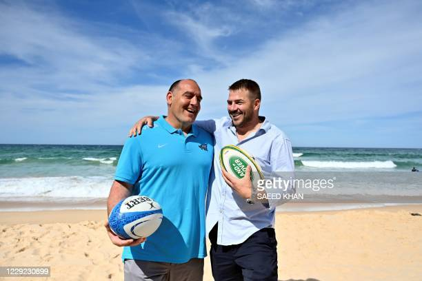 Argentina coach Mario Ledesma and former Australian player Drew Mitchell pose for pictures on Manly Beach in Sydney on October 23 ahead of trination...