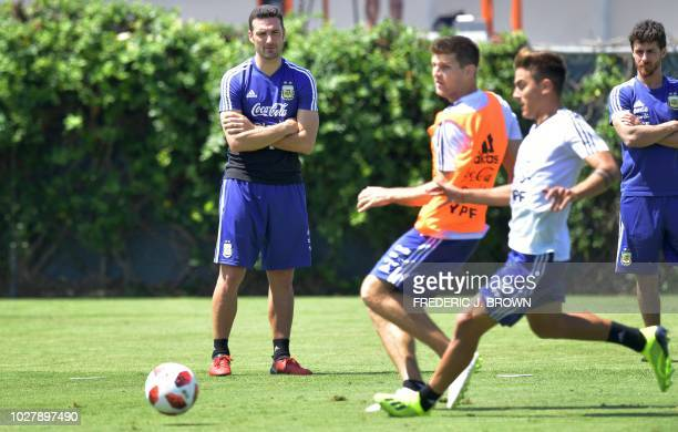 Argentina coaches Lionel Scaloni and Pablo Aimar watch players scrimmage during a training session in Carson California on September 6 ahead of the...
