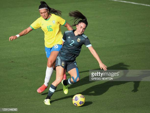 Argentina defender Agustina Barros clears the ball away from Brazilian forward Beatriz during their SheBelieves Cup international soccer tournament...
