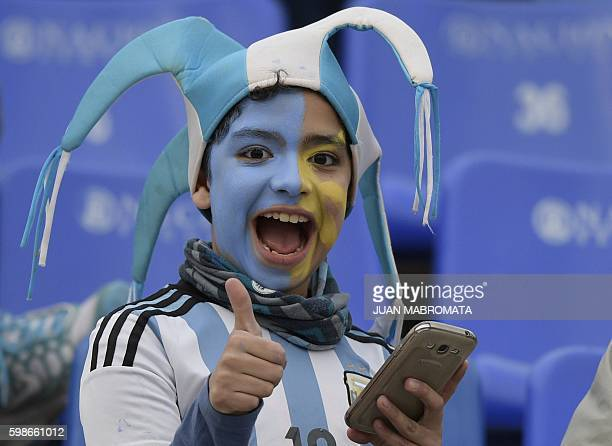 Argentina fans await for the start of the Argentina vs Uruguay Russia 2018 World Cup qualifier in Mendoza Argentina on September 1 2016 / AFP / JUAN...