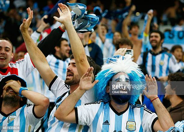 Argentina fans celebrate after defeating the Netherlands in a penalty shootout during the 2014 FIFA World Cup Brazil Semi Final match between the...