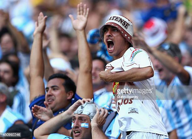 Argentina fans celebrate during the 2014 FIFA World Cup Brazil Group F match between Argentina and Iran at Estadio Mineirao on June 21 2014 in Belo...