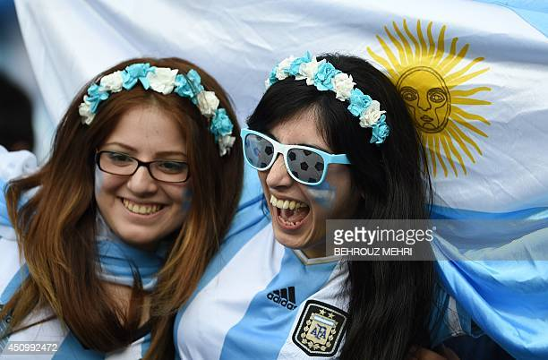 Argentina fans celebrate during the Group F football match between Argentina and Iran at the Mineirao Stadium in Belo Horizonte during the 2014 FIFA...
