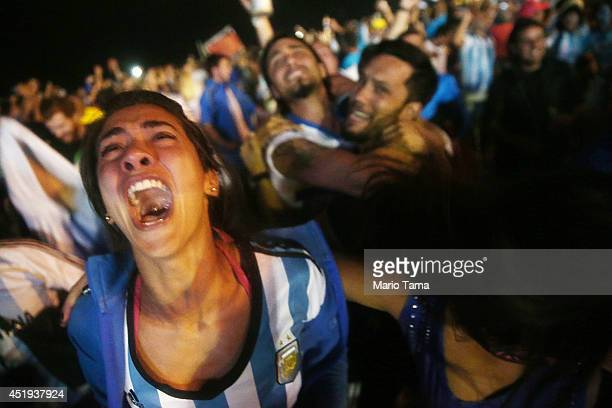 Argentina fans celebrate on Copacabana Beach after their dramatic shootout win in their match against the Netherlands in the 2014 FIFA World Cup on...