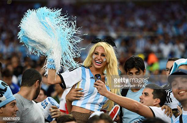 Argentina fans cheer prior to the 2014 FIFA World Cup Brazil Group F match between Argentina and BosniaHerzegovina at Maracana on June 15 2014 in Rio...