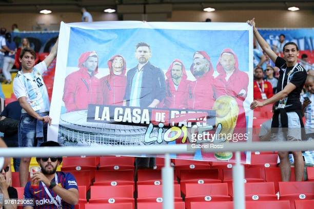 Argentina fans hold up a banner showing Lionel Messi enjoy the pre match atmosphere prior to the 2018 FIFA World Cup Russia group D match between...