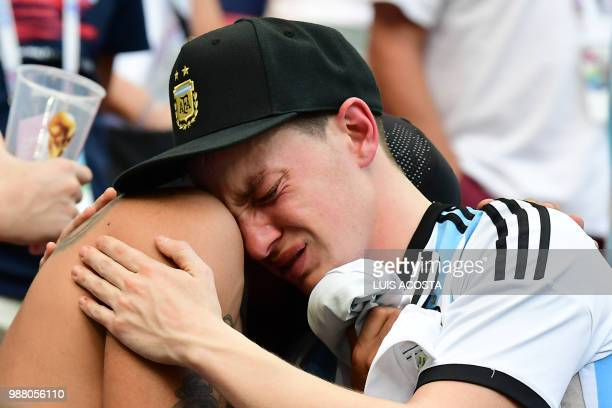 Argentina fans react to their team's defeat after the Russia 2018 World Cup round of 16 football match between France and Argentina at the Kazan...