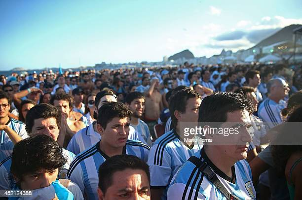 Argentina fans watch in the first half on Copacabana Beach during the 2014 FIFA World Cup final match pitting Argentina against Germany on July 13...