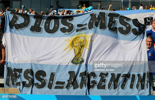Argentina fans with a flag celebrating Lionel Messi of Argentina