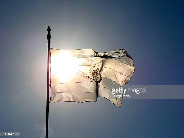 argentina flag with sun in the backlight - bandera argentina fotografías e imágenes de stock