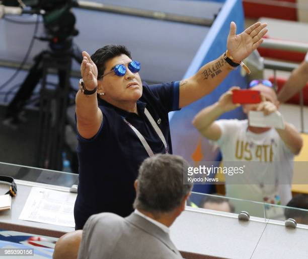 Argentina football legend Diego Maradona celebrates Argentina's equalizer during the first half of a World Cup roundof16 match against France on June...