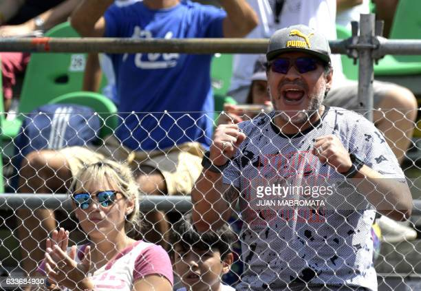 Argentina former footballer Diego Maradona cheers next to his girlfriend Rocio Oliva and his grand son Benjamin Aguero during the 2017 Davis Cup...