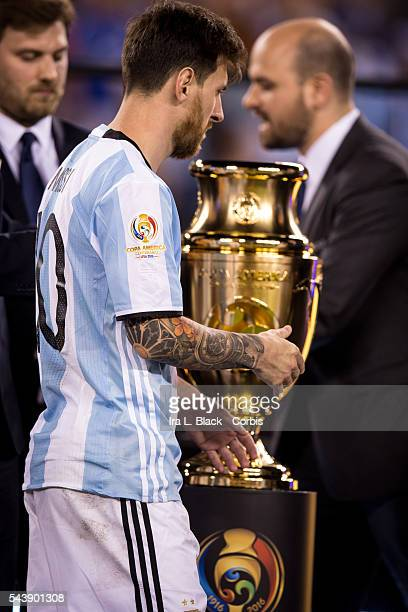 Argentina forward and captain Lionel Messi waits to take his 2nd place medal and passes the Copa America Cup after the Copa America Centenario final...