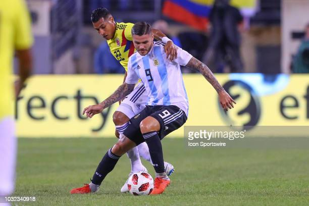 Argentina forward Mauro Icardi battles Colombia defender Jeison Murillo during the first half of the International Friendly Soccer game between...