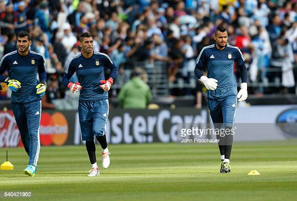 Argentina goalkeepers Sergio Romero Mariano Andujar and Nahuel Guzmán warm up before a group D match between Argentina and Bolivia at Century Link...