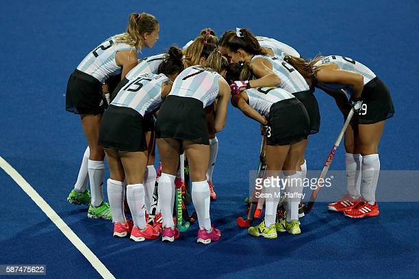 Argentina huddles against Japan during a Women's Pool B match on Day 3 of the Rio 2016 Olympic Games at the Olympic Hockey Centre on August 8 2016 in...