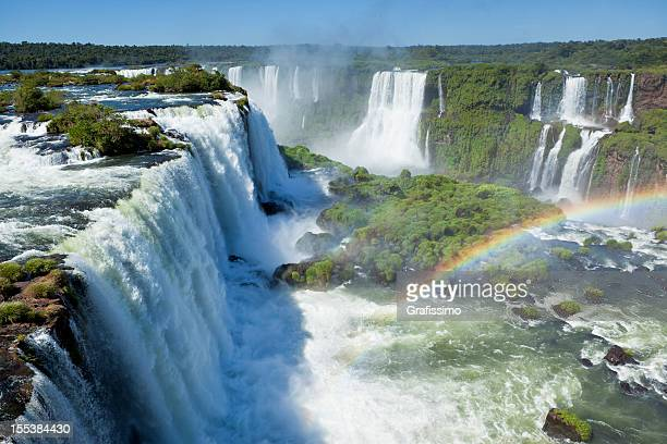 argentina iguazu waterfalls garganta del diablo with rainbow - argentina stock pictures, royalty-free photos & images