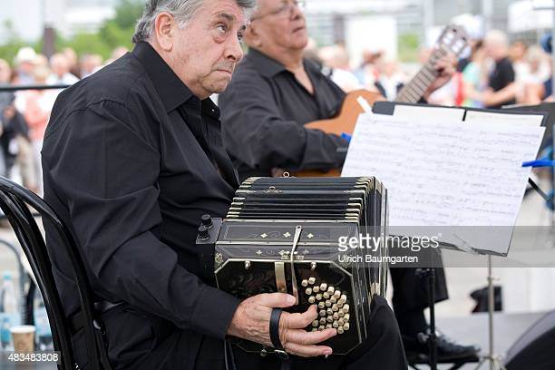 Argentina in Bonn The group Cuarteto Argentino with their Tango on the roof of the Art and Exhibition Hall In the foreground a Bandoneon and a sheet...