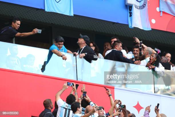 Argentina legend Diego Maradona points as fans react prior to the 2018 FIFA World Cup Russia group D match between Nigeria and Argentina at Saint...