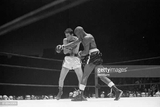 Argentina middleweight champ Farid Salim grimaces as he takes a hard right to the chin thrown by Rubin Hurrican Carter of Patterson NJ in the eighth...