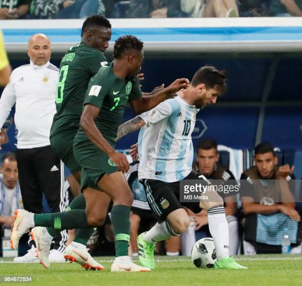 Argentina national team head coach Jorge Sampaoli looks as Lionel Messi vies for the ball with Ahmed Musa and Oghenekaro Etebo of Nigeria national...
