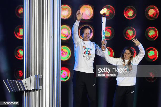 Argentina Olympians and gold medalists Santiago Lange and Paula Pareto light the Olympic Cauldron during the opening ceremony of the Buenos Aires...