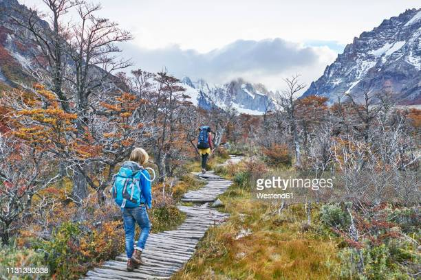 argentina, patagonia, el chalten, mother and son hiking at cerro torre in los glaciares national park - santa cruz province argentina stock pictures, royalty-free photos & images