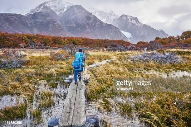 argentina, patagonia, el chalten, two boys hiking towards fitz roy in los glaciares national park - chalten stock pictures, royalty-free photos & images