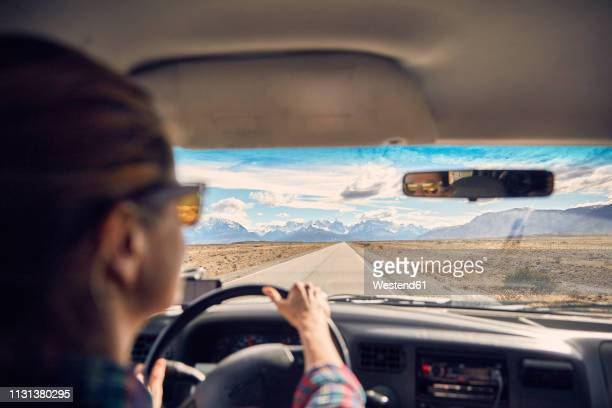 argentina, patagonia, el chalten, woman driving camper on road towards fitz roy and cerro torre - cerro torre stock-fotos und bilder