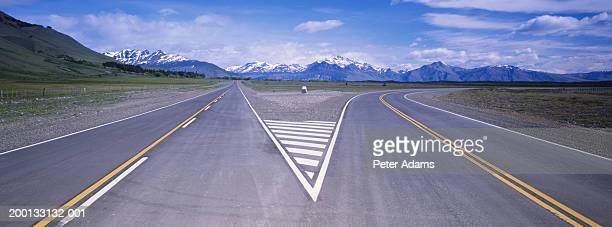 argentina, patagonia, forked road - forked road stock pictures, royalty-free photos & images