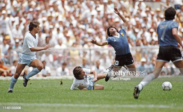 Argentina player Diego Maradona is challenged by England player Terry Fenwick as Kenny Sansom looks on during the FIFA 1986 World Cup quarterfinals...