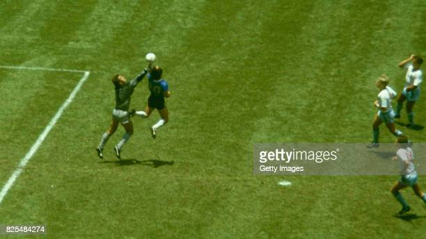 Argentina player Diego Maradona outjumps England goalkeeper Peter Shilton to score with his 'Hand of God' goal as England defenders Kenny Sansom Gary...