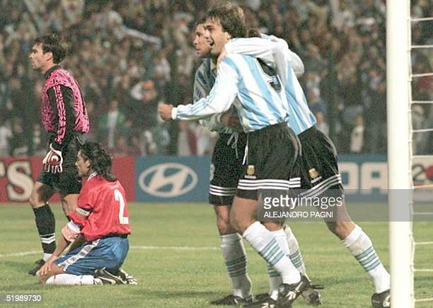 Argentina player Gabriel Batistuta who scored two goals in the group C Copa America game against Chile is congratulated by teammates Abel Balbo and...