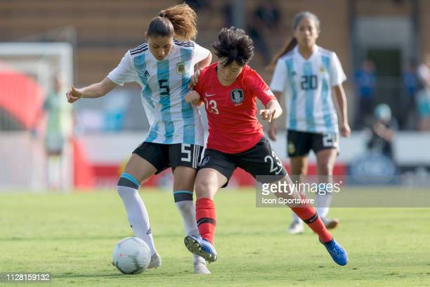 Argentina player Vanesa Santana is tackled by Korean player Chang Jang at The Cup of Nations womens soccer match between Argentina and Korea Republic...