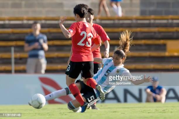 Argentina player Vanesa Santana slides to tackle Korean player Chang Jang at The Cup of Nations womens soccer match between Argentina and Korea...