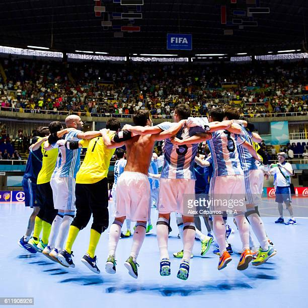 Argentina players celebrate after the victory during the FIFA Futsal World Cup final between Russia and Argentina at Coliseo el Pueblo on October 1...