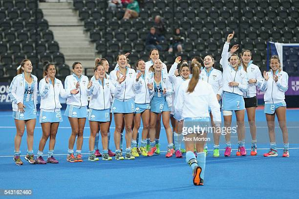 Argentina players celebrate as Carla Rebecchi walks back after being presented with her Top Scorer and Best Player awards during the FIH Women's...