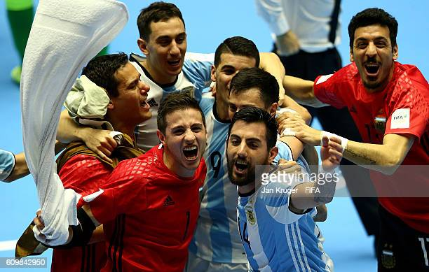 Argentina players celebrate the win in extra time during the FIFA Futsal World Cup round of 16 match between Argentina and Ukraine at Coliseo...