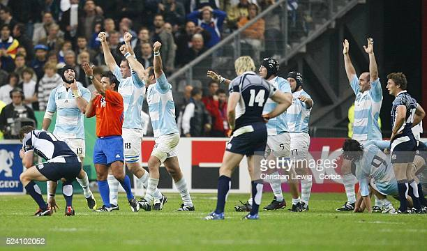 Argentina players celebrate winning the IRB World Cup rugby quarter final between Argentina and Scotland.   Location: Saint Denis, France.