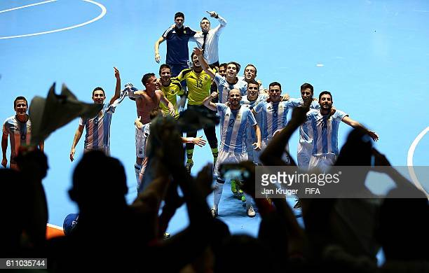 Argentina players celebrate with their fans after victory during the FIFA Futsal World Cup semifinal match between Argentina and Portugal at Coliseo...