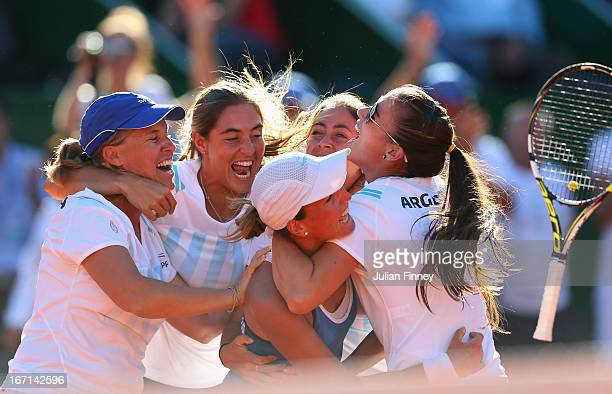 Argentina players celebrates with Maria Irigoyen of Argentina after she beat Elena Baltacha of Great Britain during day two of the Fed Cup World...