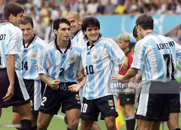 Argentina players jubilate after a goal by midfielder Ariel Ortega 21 June at the Parc des Princes stadium in Paris during the 1998 Soccer World Cup...