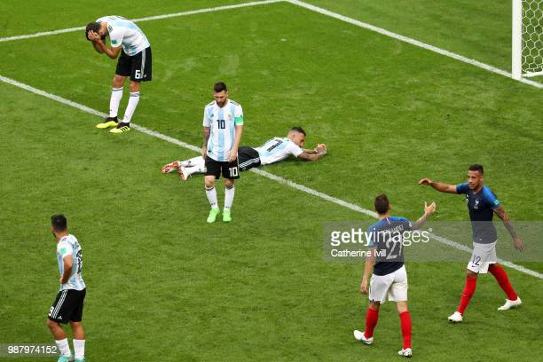 Argentina players look dejected following their sides defeat in the 2018 FIFA World Cup Russia Round of 16 match between France and Argentina at...
