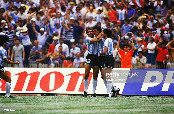 Argentina players Oscar Garre and Jose Burruchaga congratulate goalscorer Jorge Valdano after he scored the opening goal of the match during the FIFA...