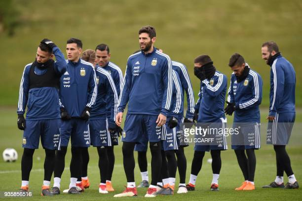 Argentina players participate in a team training session at the City Academy training complex in Manchester north west England on March 21 2018 ahead...