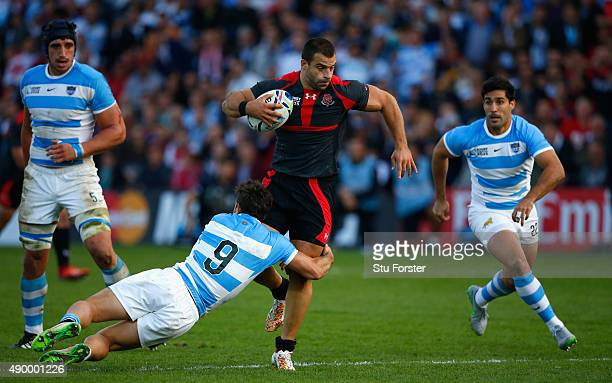 Argentina scrum half Tomas Cubelli tackles Georgia centre Davit Kacharava during the 2015 Rugby World Cup Pool C match between Argentina and Georgia...