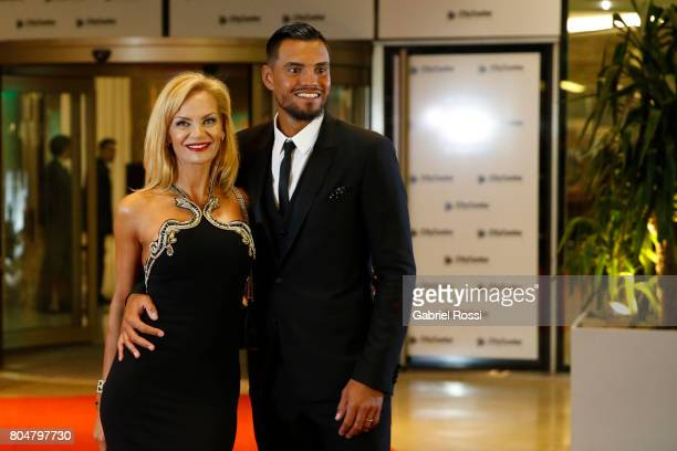 Argentina soccer player Sergio Romero and his wife Eliana Guercio pose for pictures on the red carpet during Lionel Messi and Antonela Rocuzzo's...
