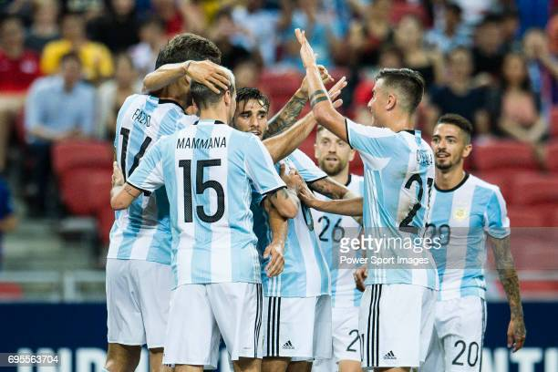Argentina Squad celebrating the opening goal of Argentina during the International Test match between Argentina and Singapore at National Stadium on...