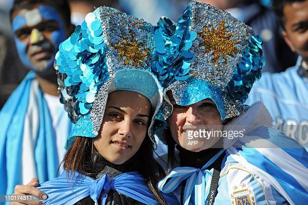Argentina supporters pose during the 2010 World Cup Group B first round football match between Argentina and South Korea on June 17 2010 at Soccer...